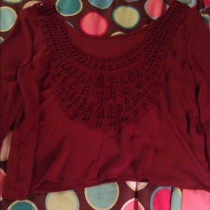 Burgundy blouse with open back design
